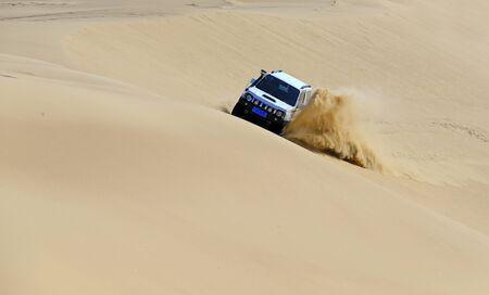 An suv was driving through the desert