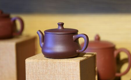 Beautiful purple clay pot, on the table 스톡 콘텐츠