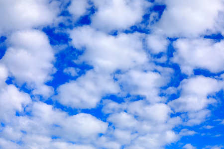 White clouds are on a clear blue sky Banque d'images