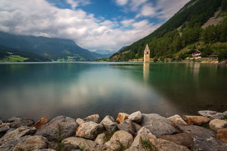 Curon bell tower landscape, Resia Lake, Italy