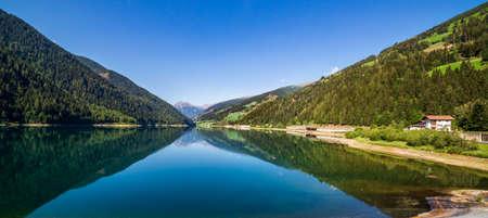 Zoccolo Lake wide landscape, Santa Valburga, Italy Imagens