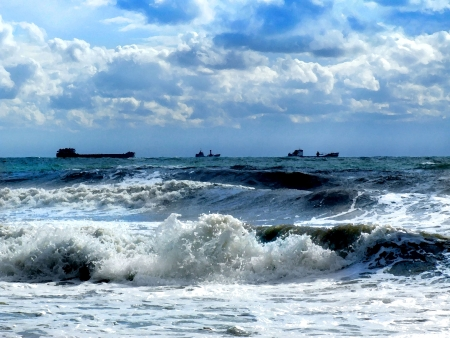 Ships in a raging sea Stock Photo