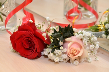 Wedding roses of groom and fiancee