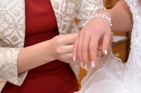 Hand of fiancee with a decoration
