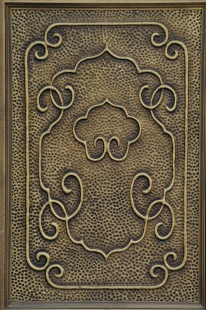 The door with bronze, carving delicate beautiful decorative pattern Stock Photo - 12390119