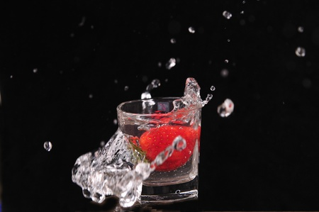Strawberry crashed into a white cup photo
