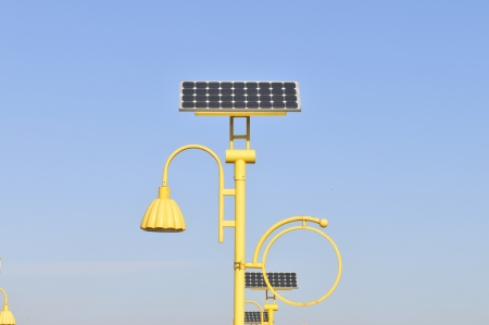 photoelectric: Street lamp post and solar panels energy  Stock Photo