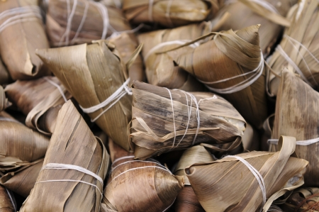 characteristic: Zongzi  zong zi  say again  JiaoShu ,  cast cylinder, the Dragon Boat Festival is a traditional festival of the han Chinese food, cast by leaf package glutinous rice steamed into  Legend is in honor of qu yuan to spread of Chinese history culture is the m Stock Photo