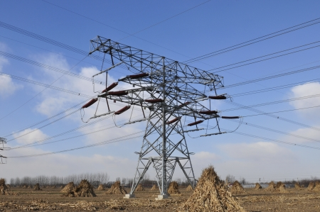 Under the blue sky of high-voltage electric tower Stock Photo - 17033034