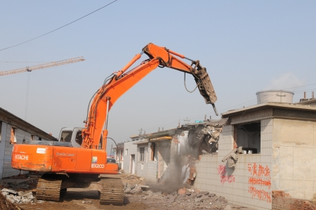 Excavators are demolished houses  Stock Photo - 18777109