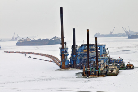 mining ships: During the winter after a cargo ship Editorial