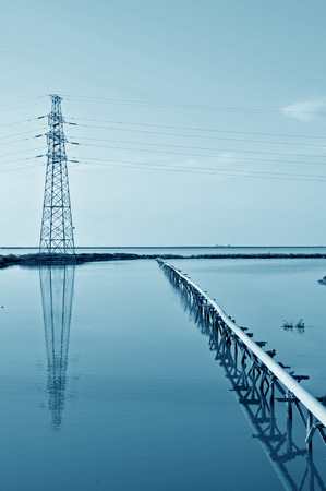 Pylon and simple reflection in the water pipe equipment photo