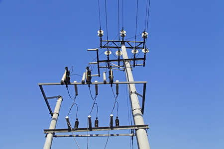 telephone poles: Telephone poles and wires and the blue sky