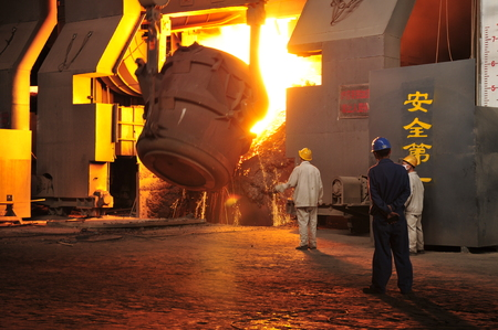 smelting: Workers in a metal smelting Stock Photo