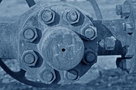 flange: Close-up valve flange nut and bolt