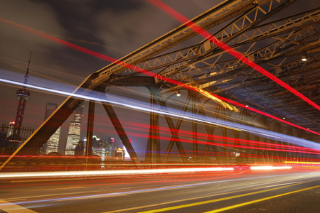 The garden bridge of Shanghai in China, the landmark with colorful light trails Stock Photo