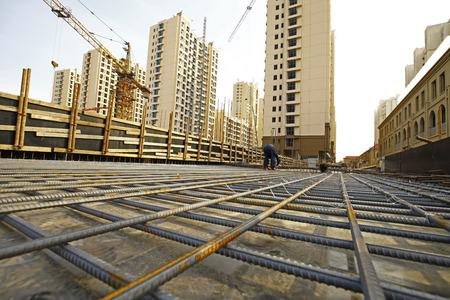 worker in the construction site making reinforcement metal framework for concrete pouring Reklamní fotografie