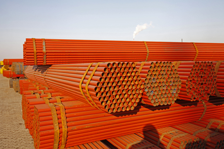 culvert: Red stacked steel pipe
