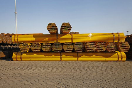 culvert: Yellow stacked steel pipe