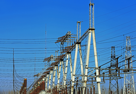 power grid: Electric power equipment, high pressure ceramic and metal stents, power grid and power lines Stock Photo
