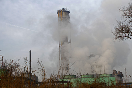 environmental damage: Steel mills Smoke and powder dust pollution in large industrial District Stock Photo