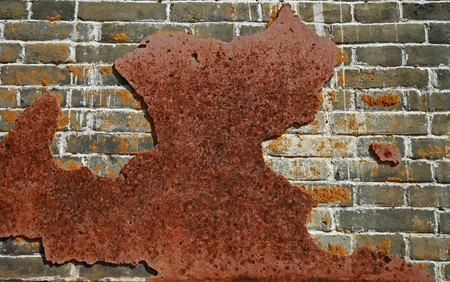 Rusty old wall hole peeling paint background