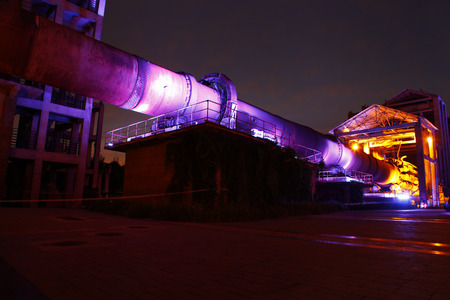 damage control: abandoned  manufacturing machinery and equipment of the factory at night