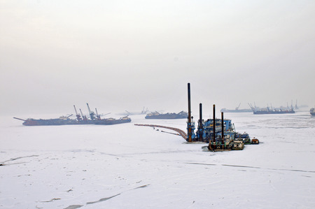 mining ship: During the winter after a cargo ship Stock Photo