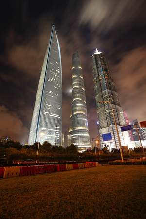 influential: On September 25, 2015, China, Shanghai ,Shanghai lujiazui financial district and commercial buildings in the evening, lujiazui is one of the most influential financial center in China. Editorial