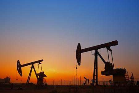 oilwell: The silhouette of the oil pump Stock Photo