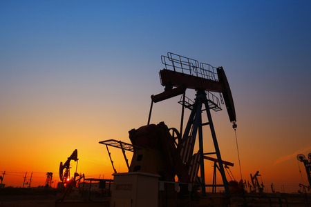 roughneck: The silhouette of the oil pump Stock Photo