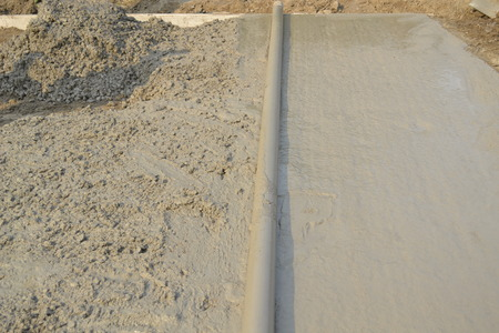 inhibition: Workers laid concrete pavement