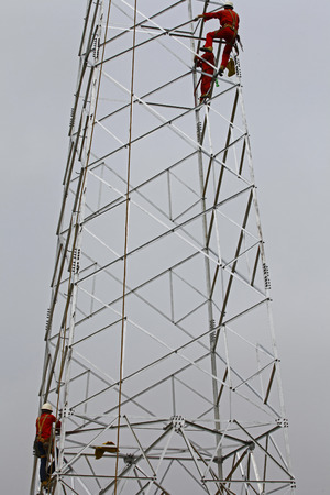 The workers on the pylon
