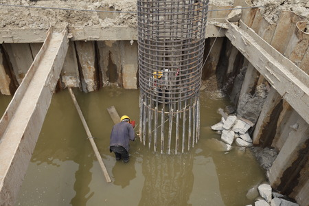 aggregation: In pile driving engineering of steel bridge construction, the welding workers at work