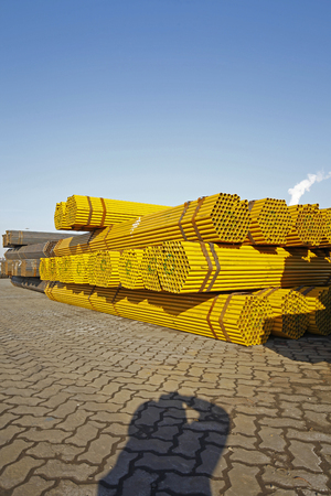 Yellow stacked steel pipe