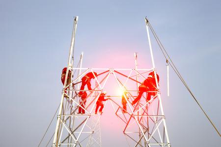 pylon: The workers of the pylon Stock Photo