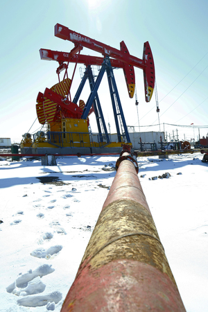 heavy snow: Oil pump, oil industry equipment in the snow