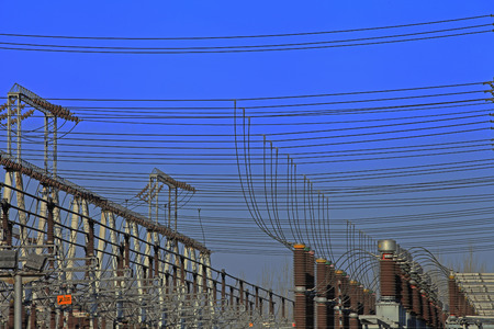 Electric power equipment, high pressure ceramic and metal stents, power grid and power lines Stock Photo