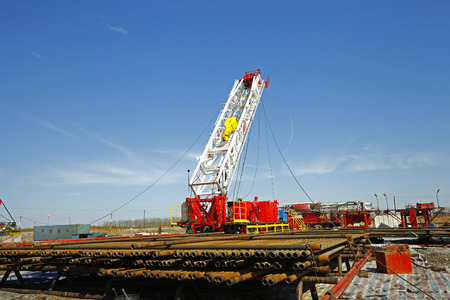 Oil pipe and oil drilling rig equipment Stock Photo