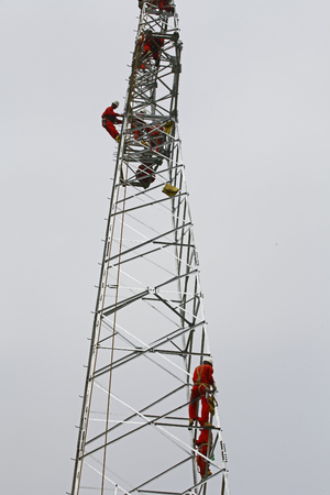 dangerous work: The workers of the pylon Stock Photo