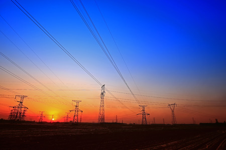 wired: pylon at the dusk Stock Photo