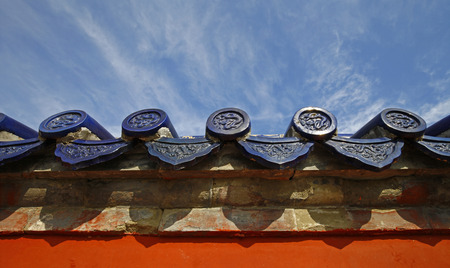 The blue glazed tiles on the wall as the background, the traditional architecture