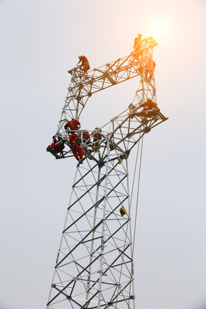 The workers of the pylon Stock Photo