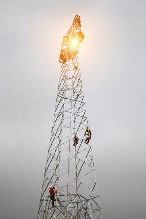 high voltage: The workers of the pylon Stock Photo