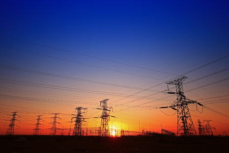 Sunset silhouette of pylon landscape view Stock Photo