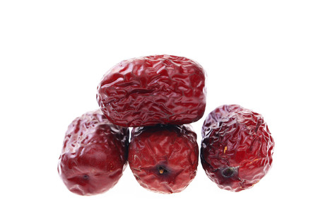 Red dates on a white background Stock Photo