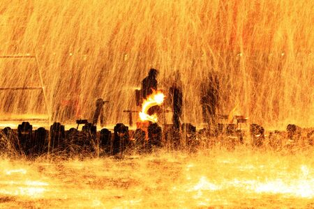 Fire sparks and molten metal splashes