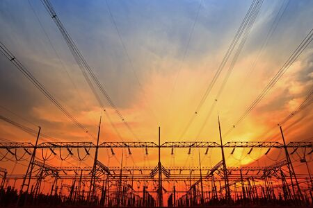 Silhouette of electric tower at sunset Stock Photo