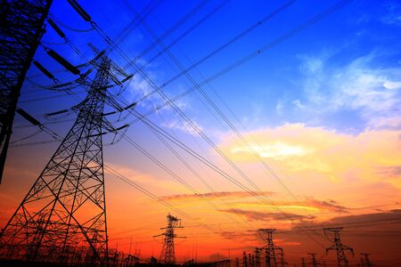 Electric tower, silhouette at sunset 写真素材