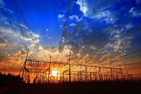 Electric tower, silhouette at sunset Stockfoto